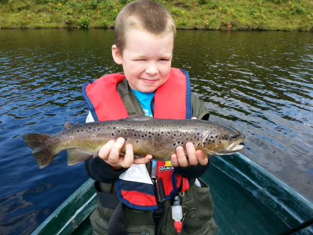 Kieran (age 7 ) caught his first brown trout weighing 2LB, 40cm fly fishing at Glengavel Reservoir on 25 August.