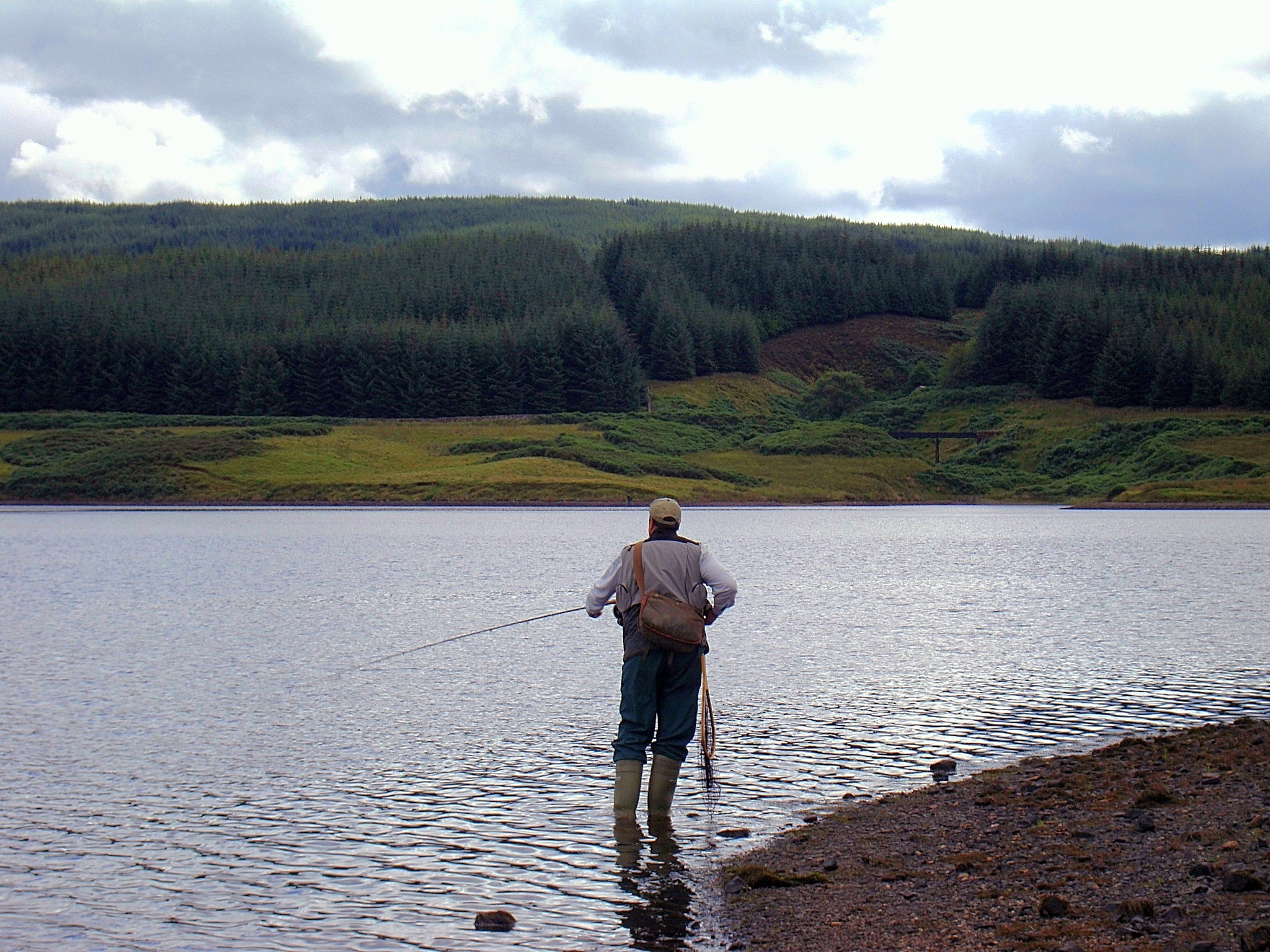 Angler Fishes The Ripple At The Boat House Point