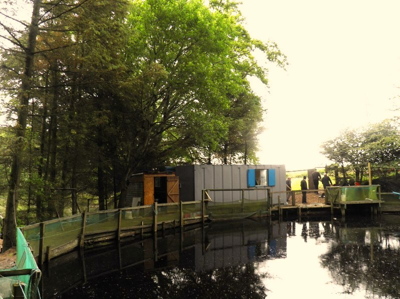 A view across the main rearing pond showing our new Club House.