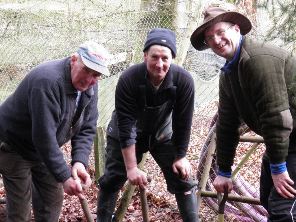 Jim , Wullie & Graeme hard at work at our rearing ponds.