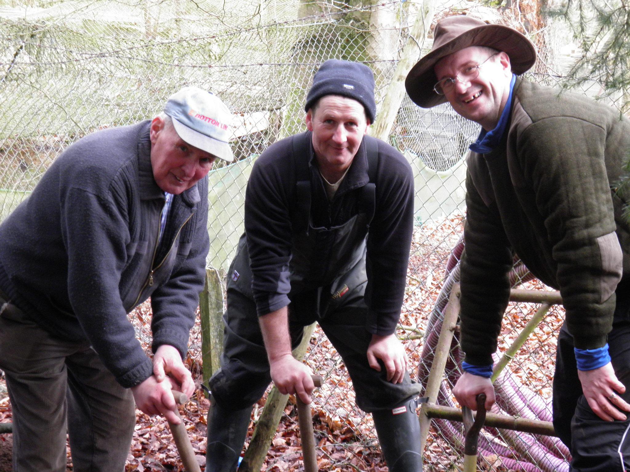 Jim , Wullie & Graeme hard at work at our rearing ponds.