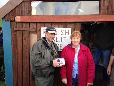 Graeme O'Brien collecting his prize from Mrs Bell